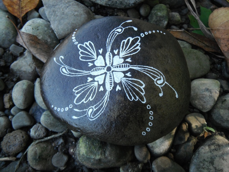 Painted river rocks with words meaningful to bride and groom.
