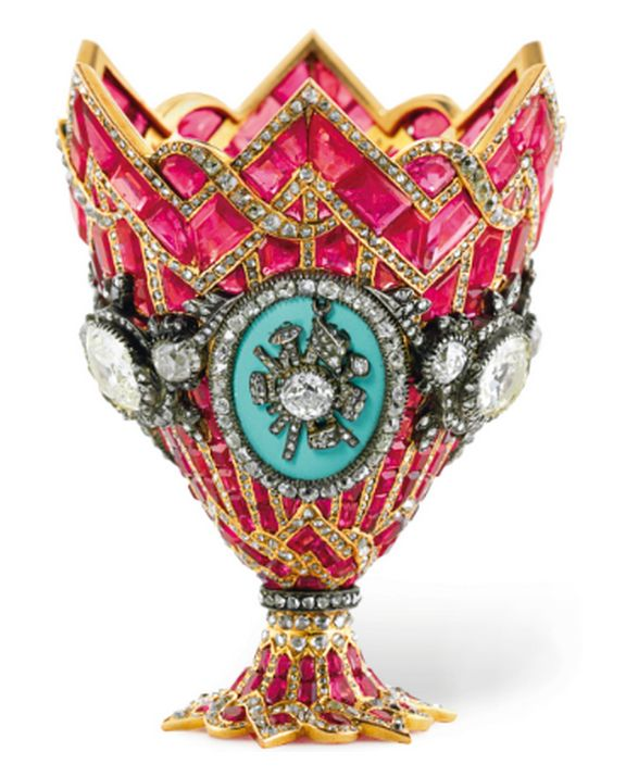 In the 1800′s, coffee drinking Turks had a bit more style than post consumer cardboard. While taking part in ceremoni‐ous coffee rituals, the simple shallow cups that held the coffee, were nestled in ornamental stands like this one, coming up for sale at Christie's for $150,000 to $200,000—get your bids in now!