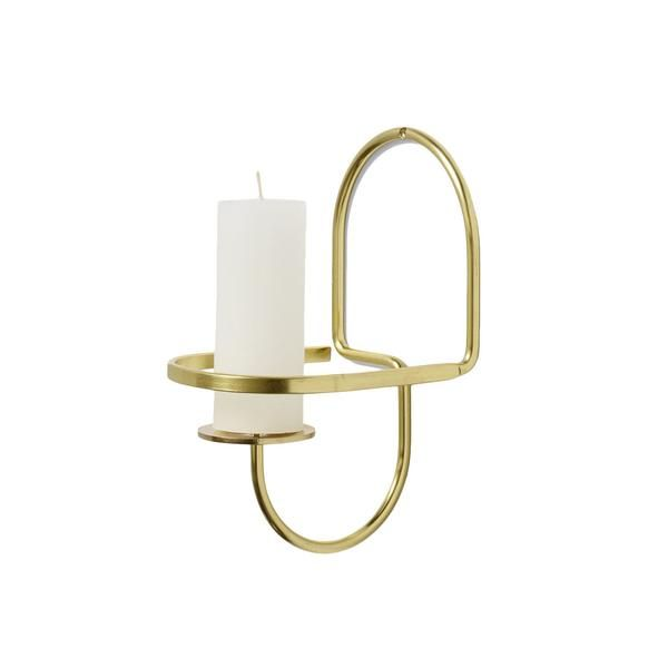 The classic candle holder transformed into a physical line drawing in brass. The new additions to the Lup family, a wall-mounted version of Lup, have the same p