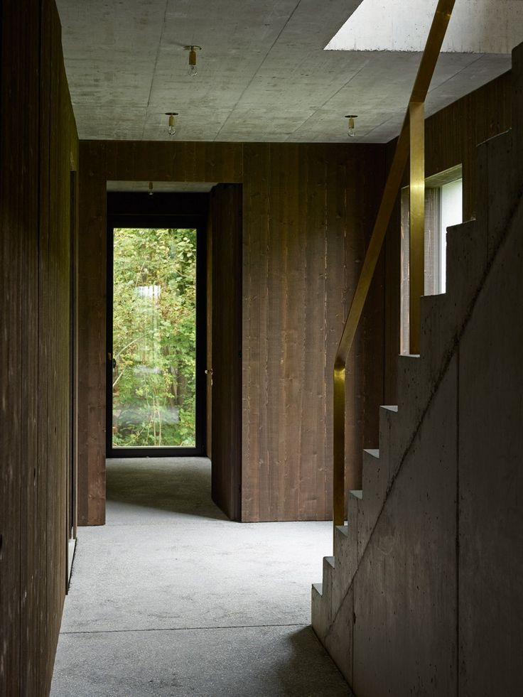 The Architecture Of This Family House Combines Raw Concrete With Dark Wood