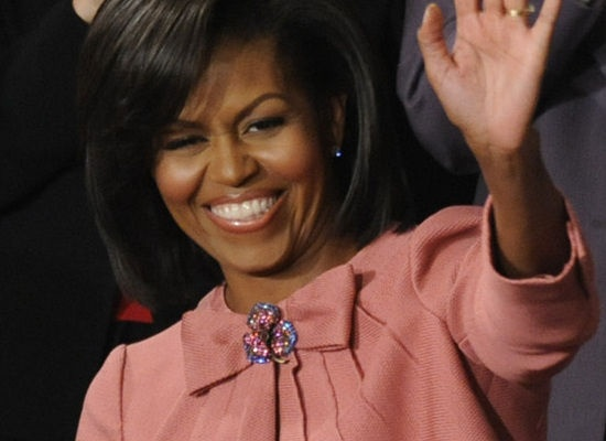 First Lady Michelle Obama's signature style includes wearing vintage brooches
