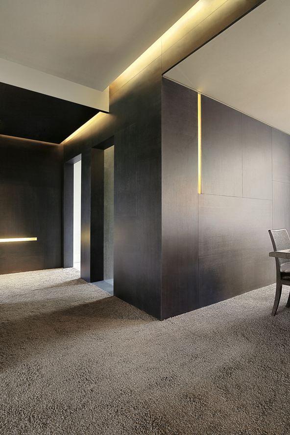 Royal Garden @ Shanghai, China by Studio Lipparini. Bjad interiors black carpets stone walls Finishes Lighting.