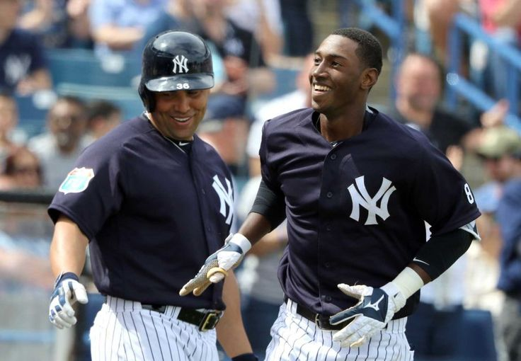 Jorge Mateo #93 of the New York Yankees celebrates with Carlos Beltran #36 after hitting a solo home run in the third inning during the game against the Boston Red Sox at George M. Steinbrenner Field on March 5, 2016 in Tampa, Florida. More spring training photos available at Newsday.com/Sports.