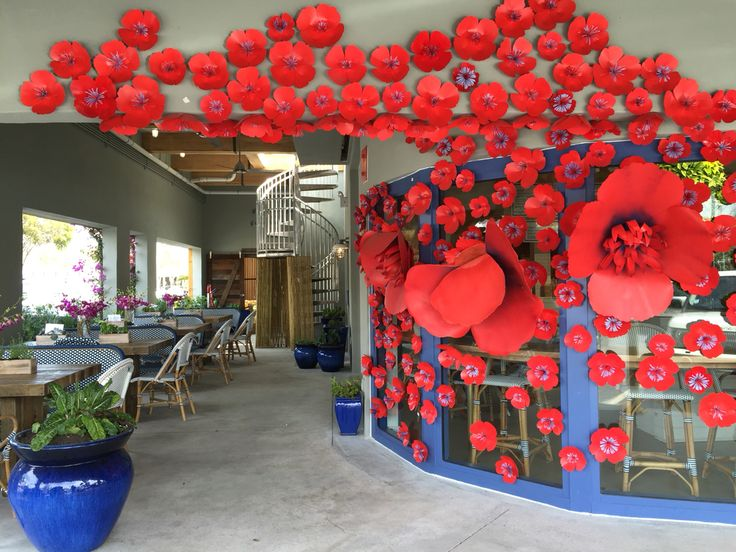 GROWN - Beautiful South Miami restaurant storefront decorated with metal flowers.