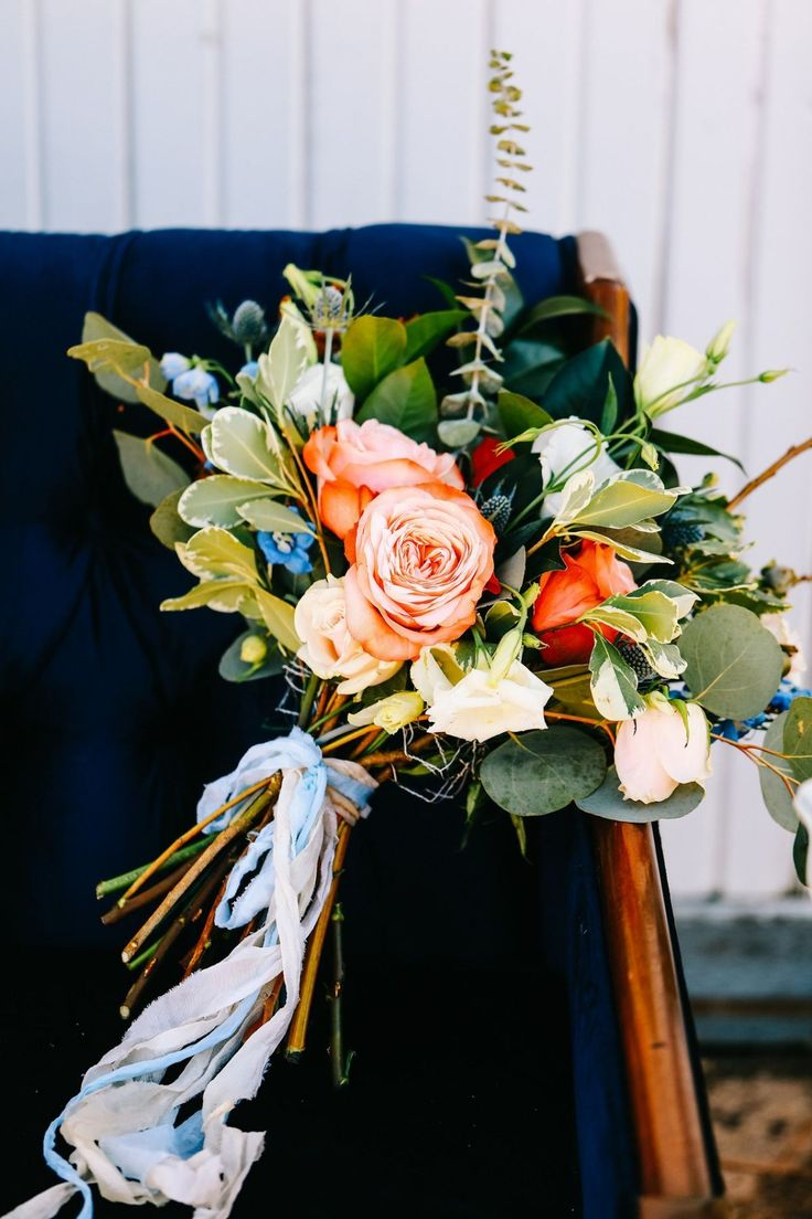 Blue, green, and peach wedding bouquets - Photo by Sarah Libby Photography