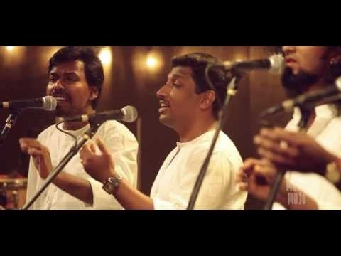 Omanathinkal kidavo by Asima - Music Mojo on Kappa TV. Asima are Anil Ram, Anoop S, Anoop Mohandas, Khalid, Vineeth George (Keyboards), Ben sam Jones (Bass and acoustic guitar), Tao Issaro (Percussion & drums). Composed and arranged by Devissaro. Mixed and mastered by Yakzan Gary Pereira. Directed by Sumesh lal