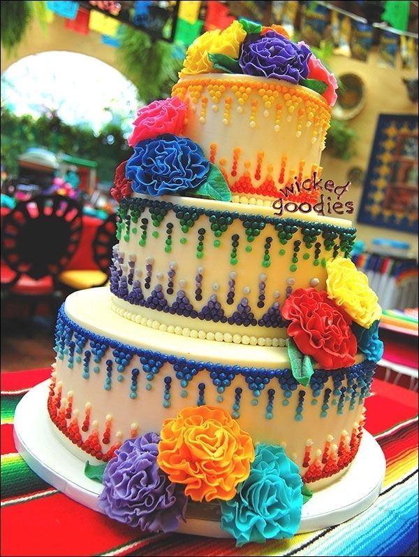 Mexican theme wedding cake with piped buttercream and fondant fantasy flowers.