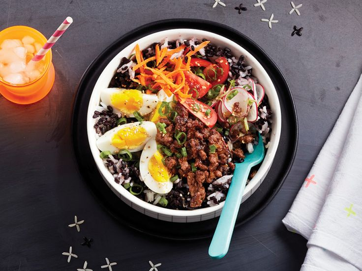 Create your own better-than-takeout rice bowl at home. Juicy ginger beef, hardboiled eggs and all the veggies are nice and cozy atop this hearty bowl.