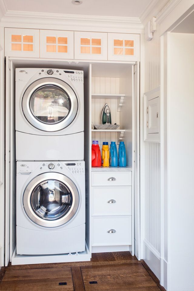Hidden Laundry Closet With Stackable Front Loading Washer And Dryer And Built In Storage Lewis Weldon C Laundry Closet Hidden Laundry Laundry Room Makeover