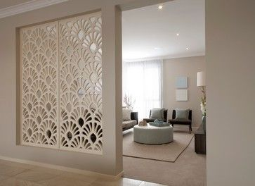 A gorgeous divider in your home to separate your living room from the walk way. We love this look!