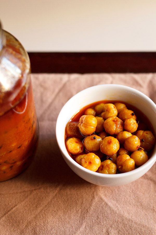 amla pickle or amla achaar recipe – one easy recipe of indian gooseberry pickle which requires no sunlight or drying in the sun. step by step recipe.