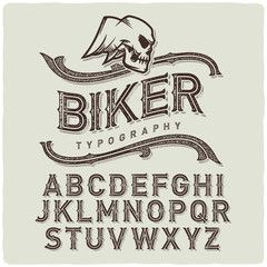 Biker style dirty letters alphabet with wings skull emblem. Light Background.