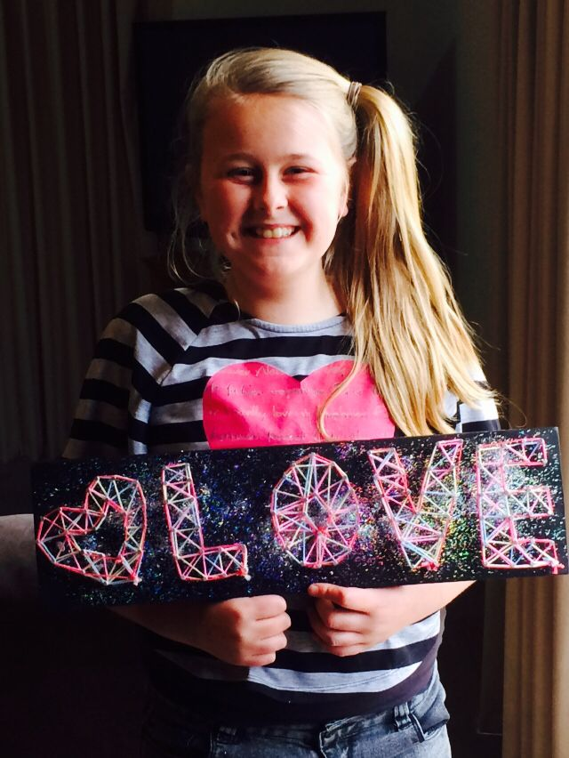 Tahlia with her string art August 2014