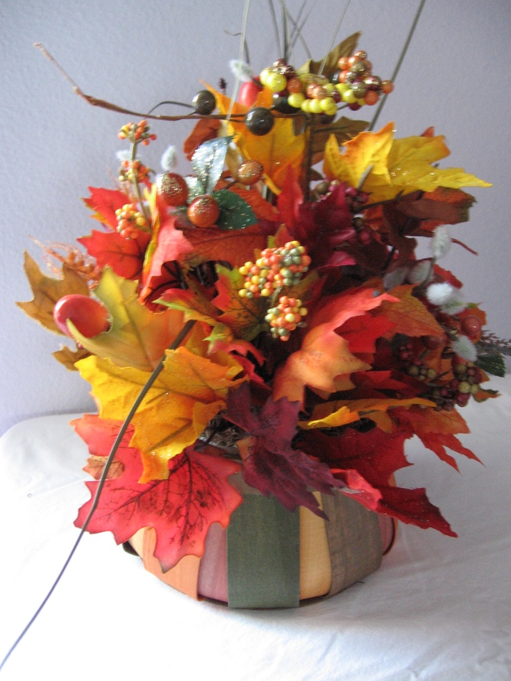 Another fall arrangement with Autumn leaves, silk flowers and buds. $24.00