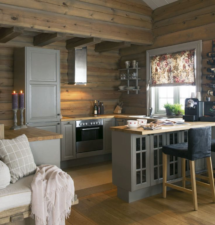 Cozy cabin kitchen. Love the gray cabinets against all the wood!
