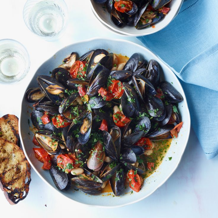 Adding white beans to mussels makes this a hearty, substantial meal; the chorizo here makes it appealingly smoky, too.