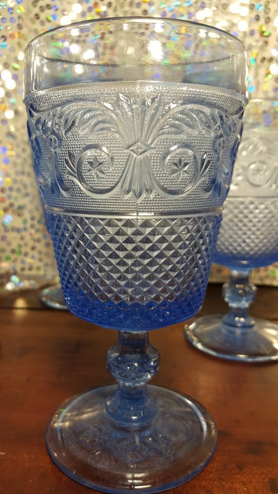 Love these goblets in the light blue. The pattern is Everyday Glass - Clear by Johnson Brothers, England. Everyday Glass features a convex bowl with a variety of beautiful embossed elements, a knobbed stem, and a smooth round base. The depth and beauty of each piece in this pattern