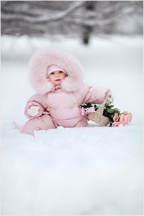 little girl bundled in Pink snow suit