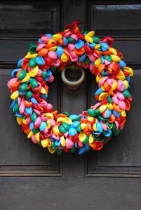 A Birthday party wreath made out of balloons! How cute to help celebrate your kids special day or anyone's for that matter!