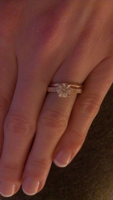 plain wedding band with blingy engagement ring. This, but oval