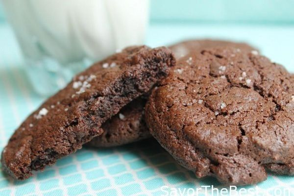 A recipe for salted chocolate fudge cookies made with dark chocolate and enhanced with a sprinkling of salt create a luxurious gourmet cookie.