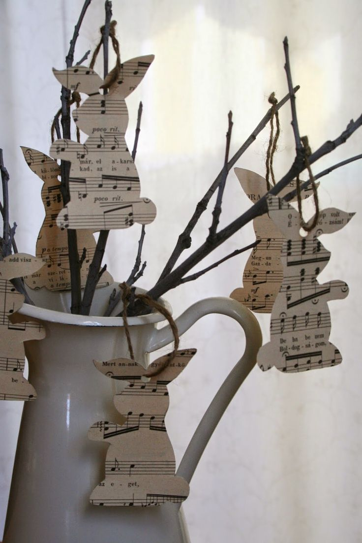 Easter bunny decor from old sheet music and twigs in vintage pitcher