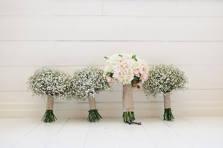 bridesmaids carry babys breath bouquet (cost effective) and bride can carry her dream flowers! So simple and pretty! I think I'd want to do this!