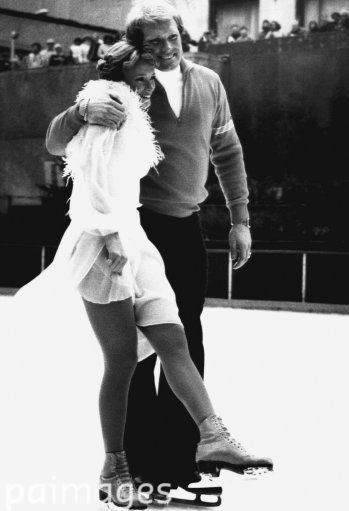 Pittsburgh Steelers quarterback Terry Bradshaw places arm around his wife, ice skating star Jo Jo Starbuck on Tuesday, Jan. 9, 1979 as they glide toward camera during taping of NBC-TV Super Bowl Saturday Night. To be broadcast on the eve of Super Bowl XIII, the two hour long special features an ice dancing routine by Miss Starbuck. Location is unknown.