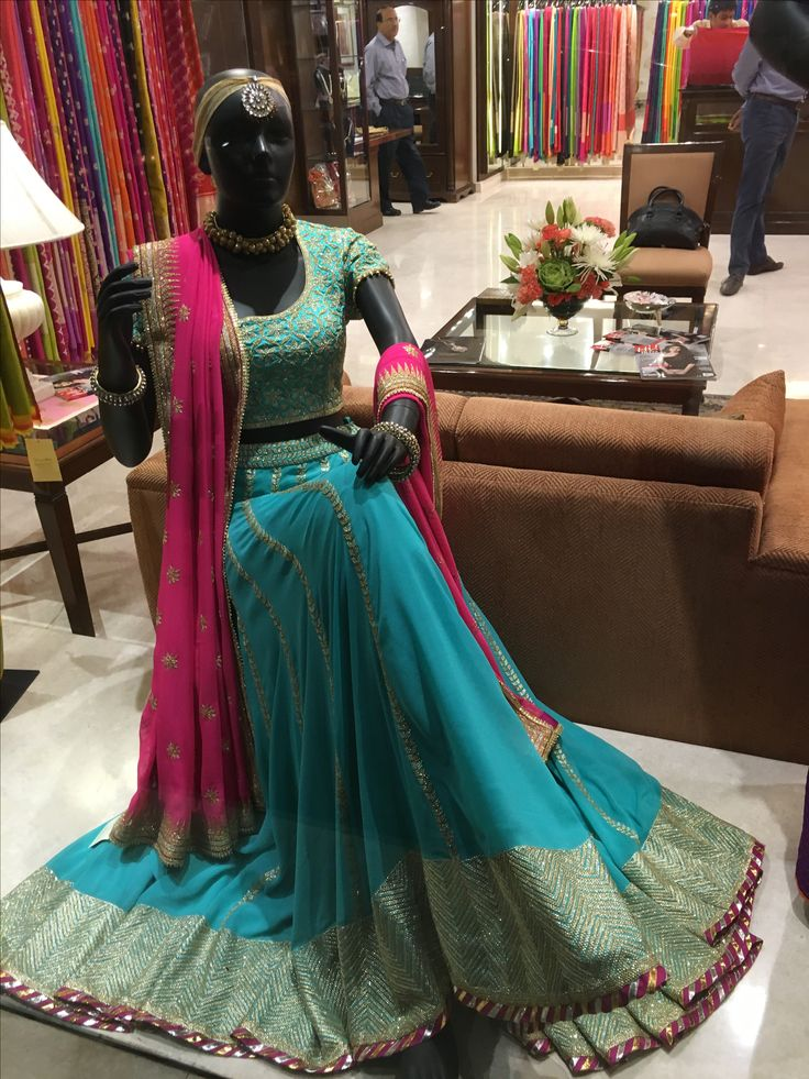Beautiful lehenga with a stunning pink dupatta for the wedding trousseau by Vidhi Singhania