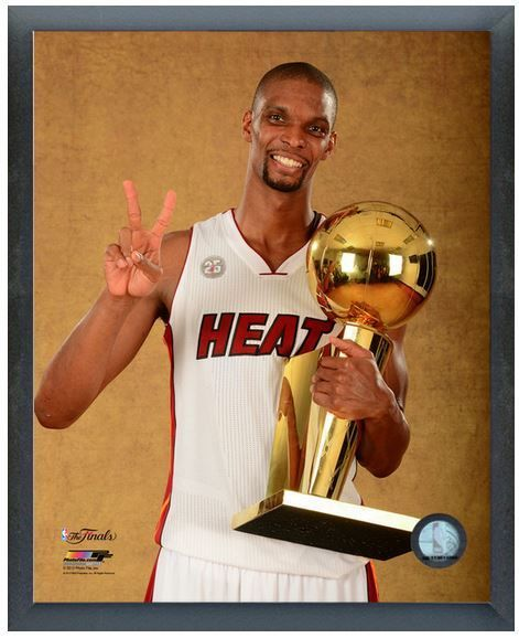 Chris Bosh with the NBA Championship Trophy after Game 7 2013 NBA Finals- 6/20/13