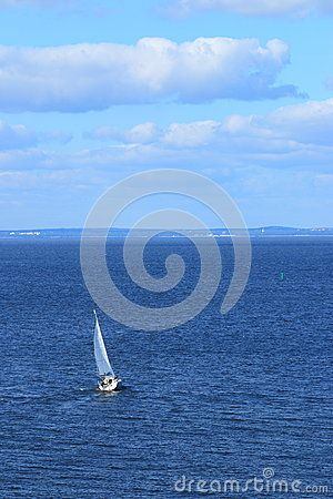 The white boat is maneuvering on a Sunny day with a rippling surface of water. General view