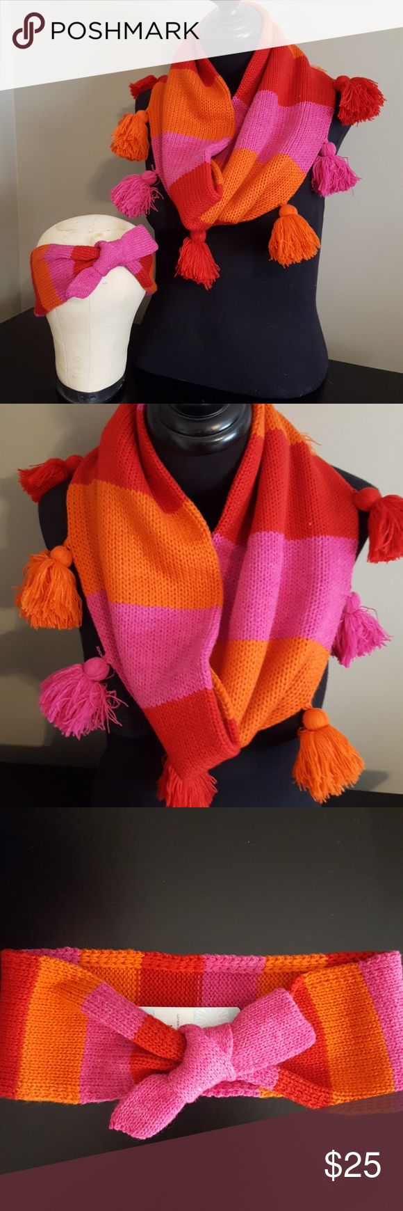 "Cozy Tasseled Infinity Scarf and Ear Band Bundle Red, Orange, and Pink Striped Infinity and Ear Band will keep you colorful and warm. The scarf has tassels and the ear band has a decorative knot. The ear band is one continuous loop so it stretches on. The ear band is 10.5"" flat and the scarf is about 33"" around. Mud Pie Accessories Scarves & Wraps"