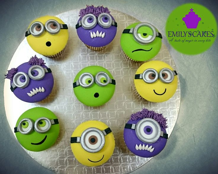 Keeping with our minions theme for the week here are the accompanying cupcakes to our recent three tier minion birthday cake. We just #loveminions they are so cute. Yay!!! #minions #minion #minionscupcakes #minionsthemedcupcakes #birthdaycupcakes #greenminion #yellowminion #purpleminion #greenminioncupcakes #amazingcupcakes #amazingminioncupcakecakes #bestcupcakesintown #bestcupcakesinjhb #EmilysCakes #emilyscakessa #EmilysCakesjhb