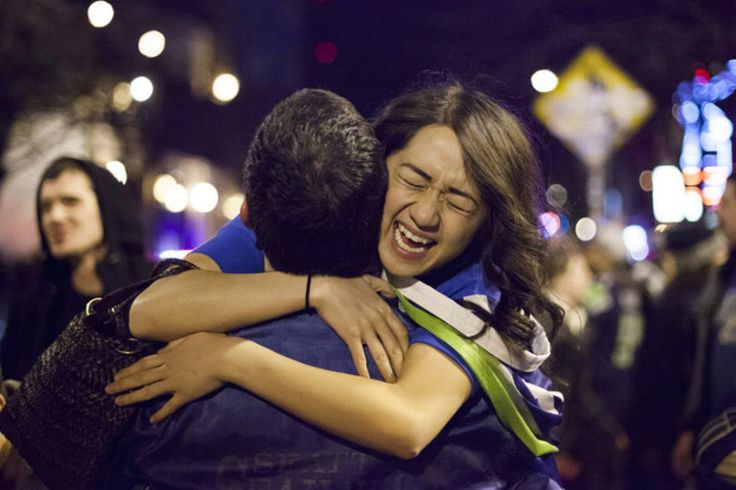Seattle Seahawks fans embrace in the street after watching their team win the Super Bowl on February 2, 2014 in Seattle, Washington. The Seahawks defeated the Denver Broncos 43-8 in Super Bowl XLVIII.