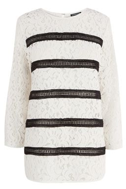 This semi-sheer lace top features a round neck, cropped sleeves and contrast stripe design to front