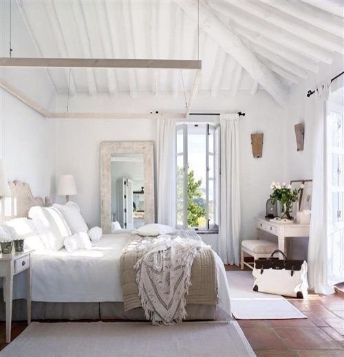 interior design: white bedroom holiday Bahamas style exposed wooden beams, whitewashed walls, white neutral bedlinen, overnight bag (mw)
