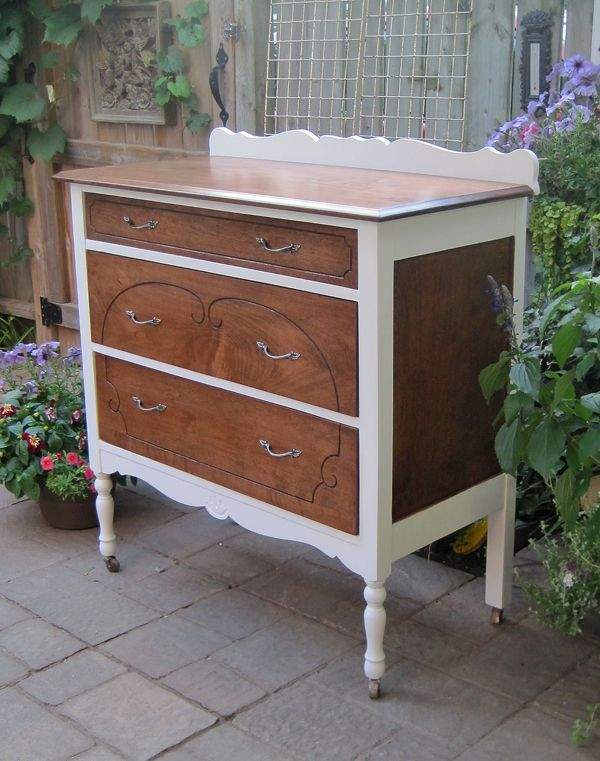 Here's a dainty maple dresser accented with white paint.