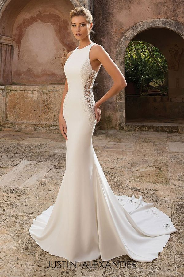 Modern crepe fit and flare wedding dress with illusion lace side cutouts.
