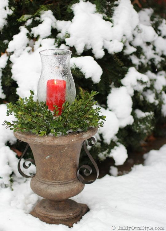 Outdoor Christmas Candle Planter - glass hurricane plant, pillar candle, and greenery clippings from the yard