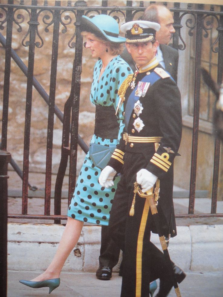 Prince Charles and Princess Diana attending the wedding of Prince Andrew to Sarah Ferguson on July.23, 1986/....Charles always seems to be looking around rather than paying attention to where they're going or to his wife.
