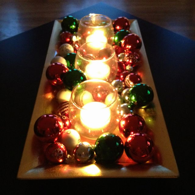 Tea lights with glass ball ornaments on a tray. Lovely and simple.