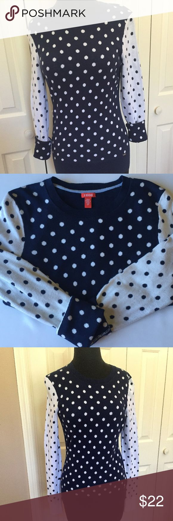"""IZOD Navy Blue & White Polka Dot Sweater-SMALL Precious ladies IZOD sweater that is Navy Blue and White Polka dots. This has a solid navy blue back, navy with white polka dots on front and white with navy polka dots on sleeves. This sweater is a size SMALL.   The sweater measures:  17"""" armpit to armpit  24"""" down center back  The sleeves measure 23.5"""" sleeve measure (from top of shoulder seam to lower edge)   It has the metal IZOD label stitched on the front. This sweater has no rips, stains…"""