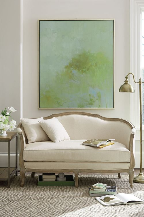 Don't be afraid to pair contemporary art with more traditional furniture - they can be a great complement!