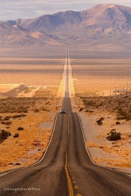 Long desert highway leading into Death Valley National Park, Nevada, USA