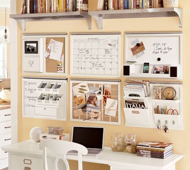 This idea uses a lot of empty wall space to organize clutter. I also love the symmetry!