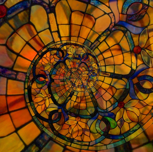 Alexandre Duret-Lutz, Recursive Stained Glass. The artist digitally created this using a mathematical repetition applied to a common license image.