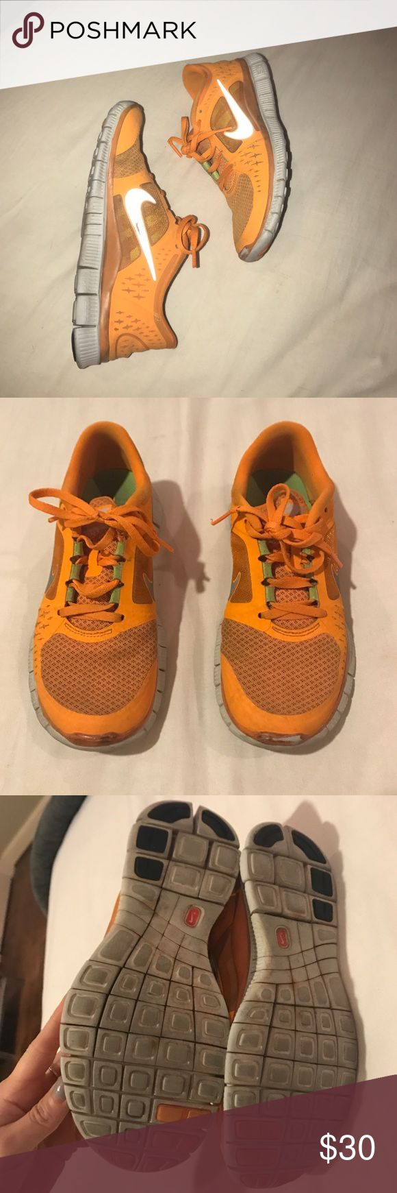 Nike free runner shoes Orange Nike free running shoes. These are pretty worn in but still look good! The color is bright and the Nike swoosh is reflective. Size 6.5. No trades please! :) Nike Shoes Athletic Shoes