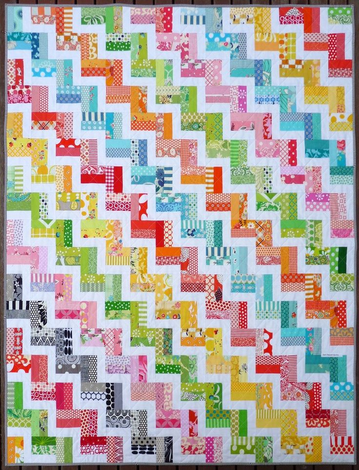 The Zig Zag Rail Fence Quilt Pattern ~ a traditional quilt design using modern fabrics, is suitable for a beginner to intermediate sewer. It requir...