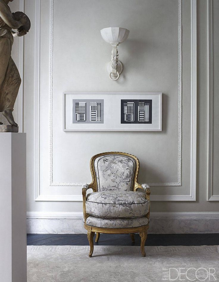 designer Ann Pyne. Screenprints by Josef Albers hang above a Louis XVI-style armchair in drawing room; sconce was a 1970 commission by French decorator Henri Samuel; oak floor is stained purple-blue.