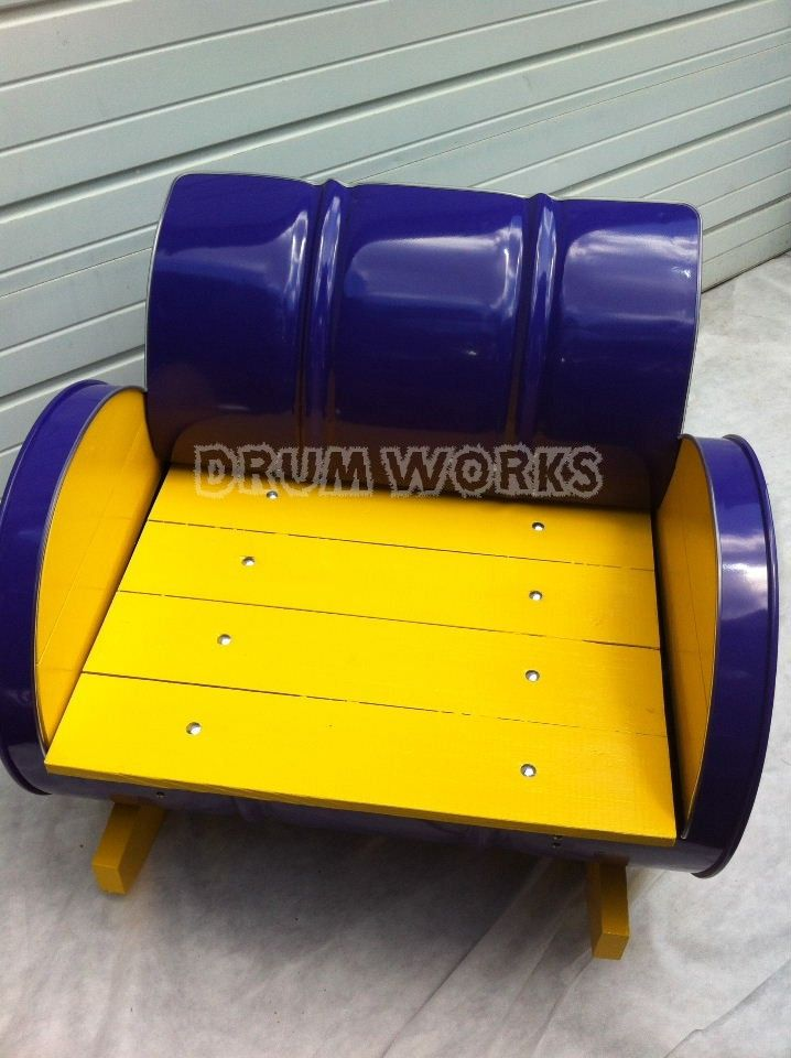 ECU colors outdoor rocker. Hand painted wood seat and accents, with dazzling purple powder coat finish. http://www.drumworksfurniture.com/